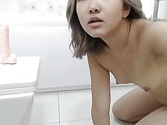 An Chinese Girl Masturbates In The Shower