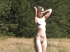 Outdoor youthfull honey swims and poses naked