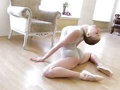 Gymnastic young shorthaired babe shows skills